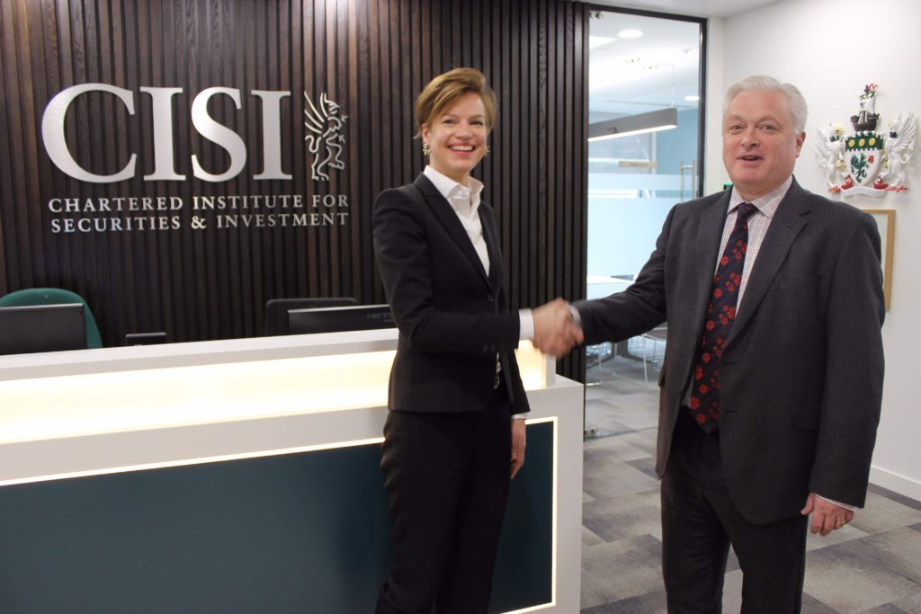Marge Tooming-Pullisaar (Chief Executive of BFAA) and Kevin Moore (CISI Global Business Development Director) signing an agreement